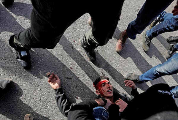 A wounded Palestinian demonstrator being helped during a protest against Israeli settlements, near the town of Beita in the Israeli-occupied West Bank on March 11.