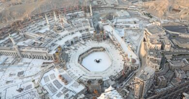 An aerial view shows an empty white-tiled area surrounding the Kaaba in Mecca's Great Mosque.